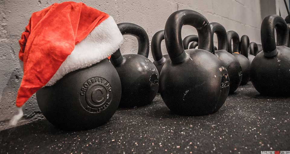 Kettle bells in the gym one has a Christmas hat on