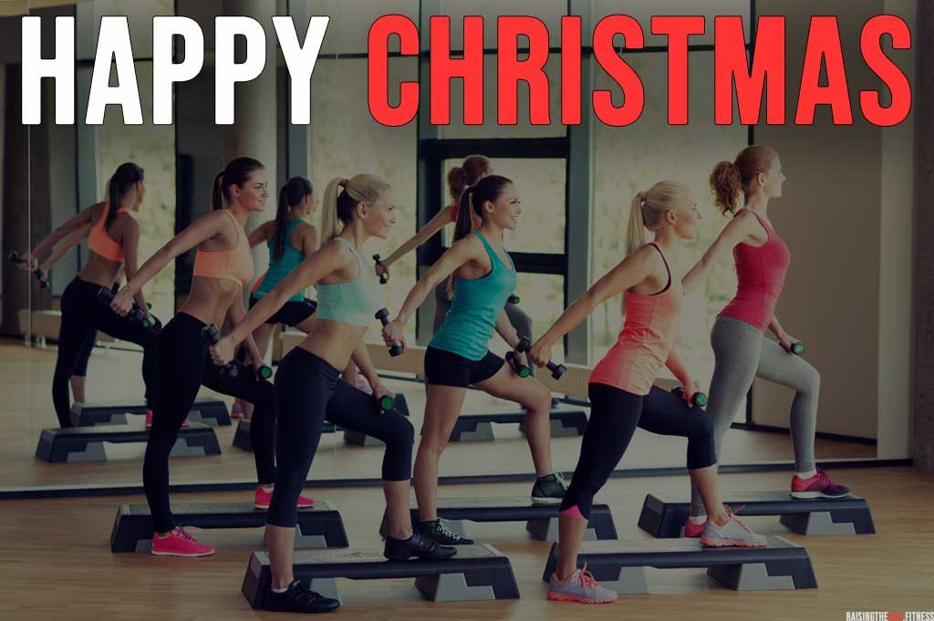 "Group of women in a fitness class preforming a tricep kickback with the words ""Happy Christmas"""