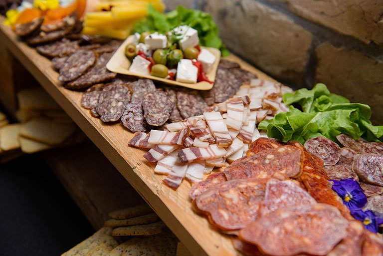 Selection of different meats, cheese, olives and lettuce