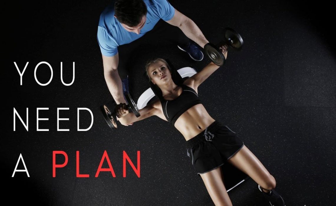 Blog post title image showing woman lying on a bench bench pressing with a personal trainer assisting her and words saying